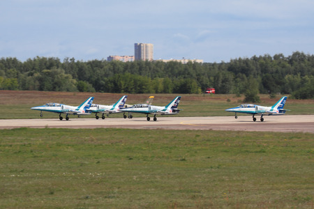 rus: ZHUKOVSKY, RUSSIA - AUGUST 19: �erobatic team Rus on L39 planes on the runway the airfield Ramenskoe at the International Aviation and Space salon (MAKS) on August 19, 2011 in Zhukovsky, Russia