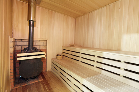 The interior of the wooden sauna with a stove