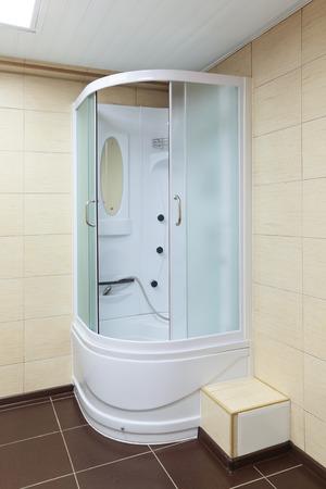 Modern white corner shower cabin, closeup photo