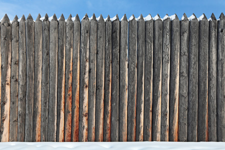 gad: The fence of acute pine logs, close-up