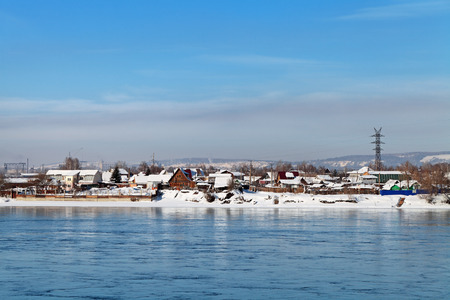 lowrise: Siberia, Russia, winter Irkutsk. Low-rise houses on the Bank of the river Angara.