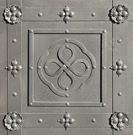 smithery: Fragment of the steel-grey gate, decorated with forged elements Stock Photo