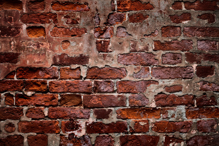 crumbling: The old dark crumbling brick wall Stock Photo