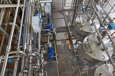 concomitant: The interior of the brewery. Concomitant production of machine - preparation of drinking water. Stock Photo