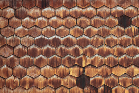 Old wooden texture in the form of tiles, consisting of a set of hexagonal plates photo