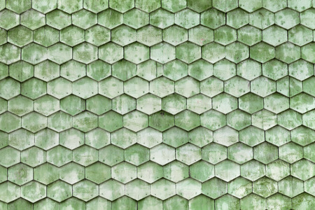 Old green wooden texture in the form of tiles, consisting of a set of hexagonal plates photo