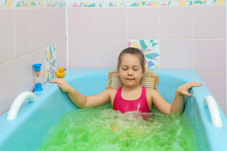 A little girl takes the salt bath at the sanatorium Standard-Bild