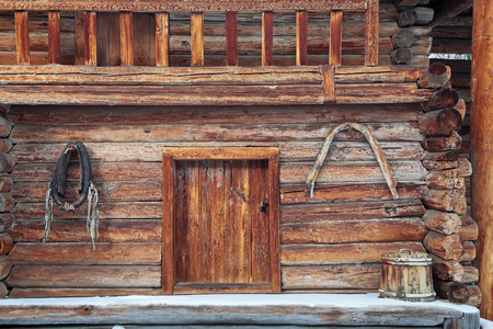 old items: View of the entrance to the old log cabin rustic house and household items Stock Photo
