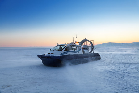 hovercraft: Hovercraft transport on the frozen lake Baikal at the time of sunset, Siberia, Russia Stock Photo