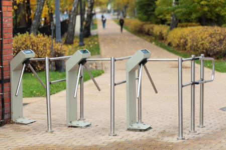 fee: Turnstiles at the entrance to the city Park, the entrance fee Stock Photo