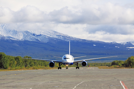 inhibition: A passenger plane landed at the airfield in the mountains Stock Photo