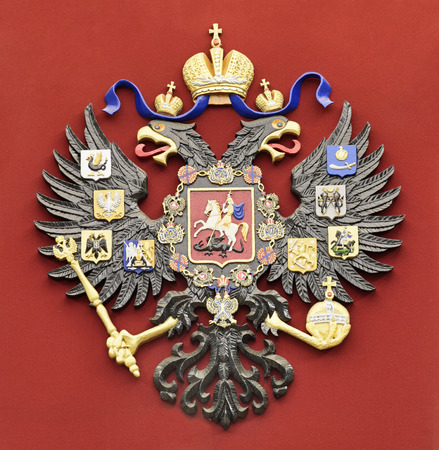Coat of arms of the Russian Federation on a red background Stock Photo