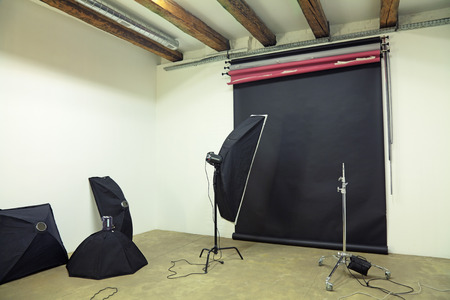interior lighting: The interior of the studio with lighting equipment and backgrounds Stock Photo