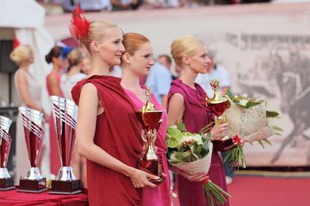 MOSCOW, RUSSIA - JUL 07: The races for the prize of the President of the Russian Federation on Jul 07, 2012 in Moscow. Girls fashion models at the ceremony of awarding the winners