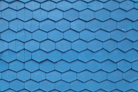 Old blue wooden texture in the form of tiles, consisting of a set of hexagonal plates photo