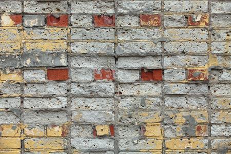 crumbling: The old crumbling brick wall