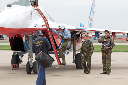 KUBINKA, MOSCOW OBLAST - MAY 06: Celebrations of the 20th anniversary of the flight groups Strizhi and Russian Knights (Russkie Vityazi) on aerodrome Kubinka May 6, 2011 in Moscow oblast, Russia. The pilot of flight group Strizhi, out of the airplane afte