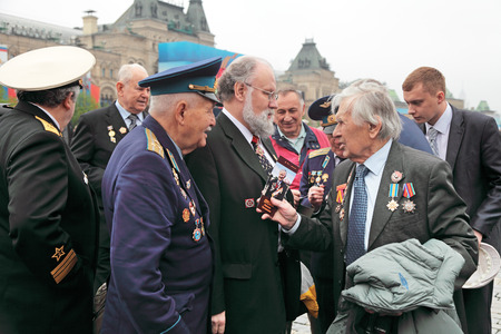 election commission: MOSCOW - MAY 09: Celebration of the 67th anniversary of the Victory Day (WWII) on Red Square on May 9, 2012 in Moscow, Russia. The Chairman of the Central Election Commission of Russia Vladimir Churov on Red Square communicates with veterans