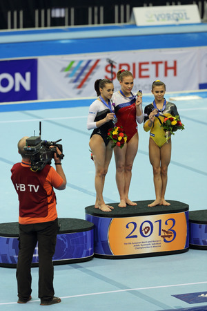 rou: MOSCOW - APR 21: 2013 European Artistic Gymnastics Championships. Awarding of winners Floor Exercise - Ksenia Afanasyeva (RUS), Larisa Iordache (ROU) and Diana Bulimar (ROU) in Olympic Stadium on April 21, 2013 in Moscow, Russia Editorial