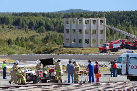 industrially: NIZHNY TAGIL, RUSSIA- AUG 22: The demonstration of the work of the rescuers and ambulance - the salvation of people from the emergency car at the exhibition RUSSIAN DEFENCE EXPO 2012 on August, 22, 2012 in Nizhny Tagil, Russia Editorial