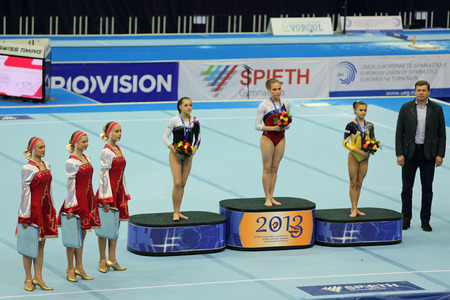 rou: MOSCOW - APR 21: 2013 European Artistic Gymnastics Championships. Awarding of winners Floor Exercise - Ksenia Afanasyeva (RUS),  Larisa Iordache (ROU) and Diana Bulimar (ROU) in Olympic Stadium on April 21, 2013 in Moscow, Russia