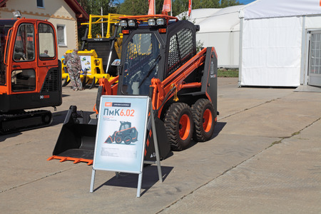 NIZHNY TAGIL, RUSSIA- AUG 22: Compact loader with Dozer equipment at the exhibition RUSSIAN DEFENCE EXPO 2012 on August, 22, 2012 at Nizhny Tagil, Russia
