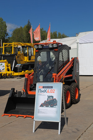 industrially: NIZHNY TAGIL, RUSSIA- AUG 22: Compact loader with Dozer equipment at the exhibition RUSSIAN DEFENCE EXPO 2012 on August, 22, 2012 at Nizhny Tagil, Russia