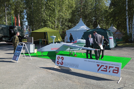 distantly: NIZHNY TAGIL, RUSSIA- AUG 22: Israeli UAV Outpost, the production Ural Works of Civil Aviation at the exhibition RUSSIAN DEFENCE EXPO 2012 on August, 22, 2012 at Nizhny Tagil, Russia
