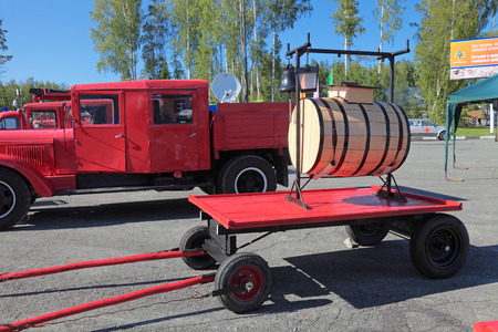 NIZHNY TAGIL, RUSSIA- AUG 22: Fire retro appliances - wooden barrel for the water to the cart at exhibition RUSSIAN DEFENCE EXPO 2012 on August, 22, 2012 at Nizhny Tagil, Russia