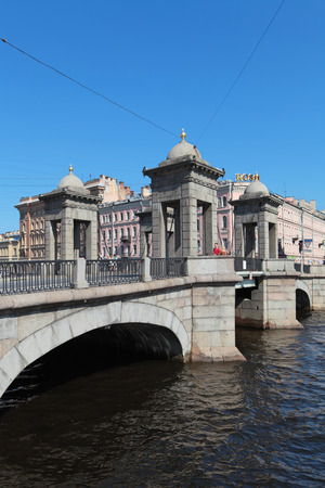 bridged: ST.-PETERSBURG-JUL 06: Lomonosov Bridge across the Fontanka River is the best preserved of towered movable bridges that used to be typical in the 18th century on Jul 06, 2013 in St.-Petersburg, Russia Editorial
