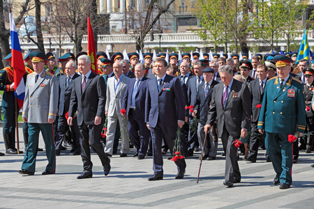 duma: MOSCOW - MAY 8: Measures of Moscow Sergey Sobyanin and deputy Chairman of the Moscow city Duma Andrey Metelsky lays flowers to the monument Tomb of the Unknown Soldier in Alexander Garden. Festive events dedicated to the 67th Anniversary of Victory Day (W