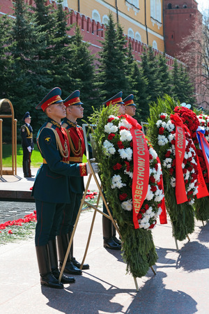 assigned: MOSCOW - MAY 8: A wreaths and red carnations assigned to the monument Tomb of the Unknown Soldier in Alexander Garden. Festive events dedicated to the 67th Anniversary of Victory Day (WWII) on MAY 8, 2013 in Moscow, Russia