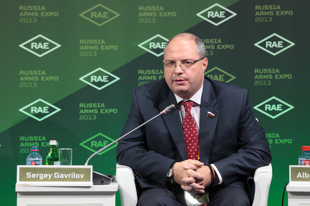 parliamentarian: NIZHNY TAGIL, RUSSIA - SEP 25: Sergey Gavrilov - the Chairman of the Committee on property of the State Duma of the Federal Assembly of the Russian Federation at the exhibition RUSSIA ARMS EXPO (RAE-2013) on September, 25, 2013 at Nizhny Tagil, Russia Editorial