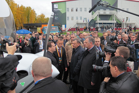 the statesman: NIZHNY TAGIL, RUSSIA - SEP 26: Government delegation headed by Prime Minister Dmitry Medvedev at the exhibition RUSSIA ARMS EXPO (RAE-2013) on September, 26, 2013 at Nizhny Tagil, Russia Editorial