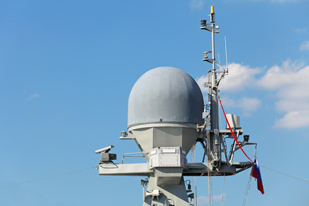 Antenna of the radar and other equipment on the deck of a modern military ship