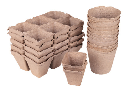 Much peat pots for growing seedlings, isolated on white