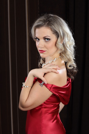 red evening: Portrait of a girl in a red evening dress on a dark  Stock Photo