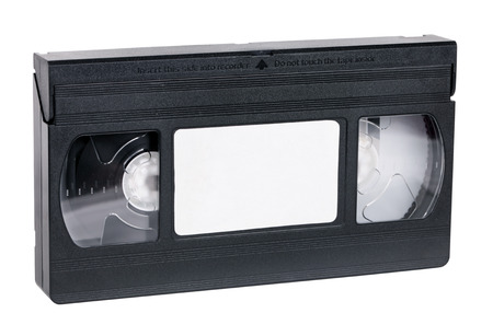videocassette: VHS estándar video cassette viejo, aislado en blanco Foto de archivo