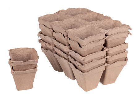 peaty: Much peat pots for growing seedlings, isolated on white