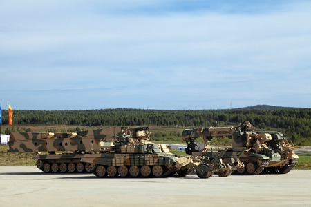 bridged: Engineering military vehicles at the firing range - bridgelayer, demining machine and the machine mouldboard