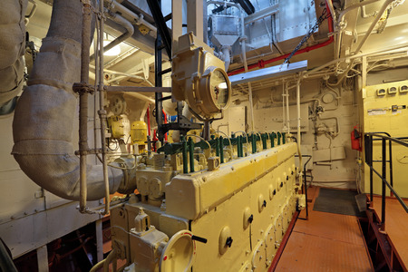 The diesel engine in the hold of the old ship