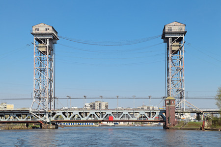 bridged:  Kaliningrad, Russia, old mechanical lifting bridge on the river Pregolya built in 1923