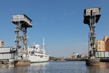 bridged: Kaliningrad, Russia, old mechanical lifting bridge on the river Pregolya built in 1923 Stock Photo