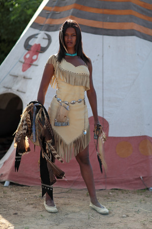 swarty: Portrait of a thoughtful Indian against the teepee