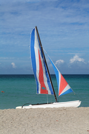 floats: A sailing boat on the shore of the Indian ocean, the Republic of Cuba