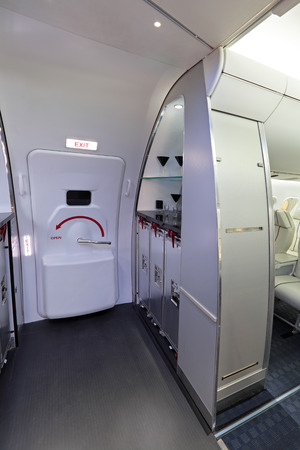 within: The door to exit in the passenger aircraft