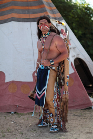 teepee: Indian stands about his teepee