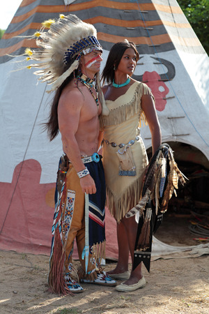 swarty: Indians man and woman stand against the background of teepee Stock Photo