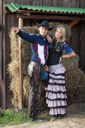 Young Sheriff with a woman at the ranch Stock Photo