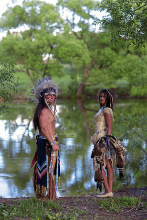 swarty: Indian chief with a young Indian on the banks of the river